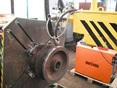 Installation for hardfacing of crane wheels